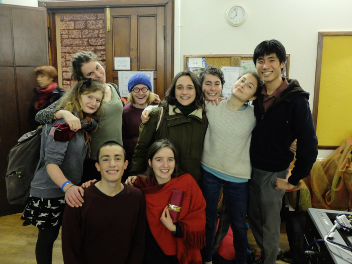Benjamin (far right) with Transition's student volunteers at last year's Christmas party