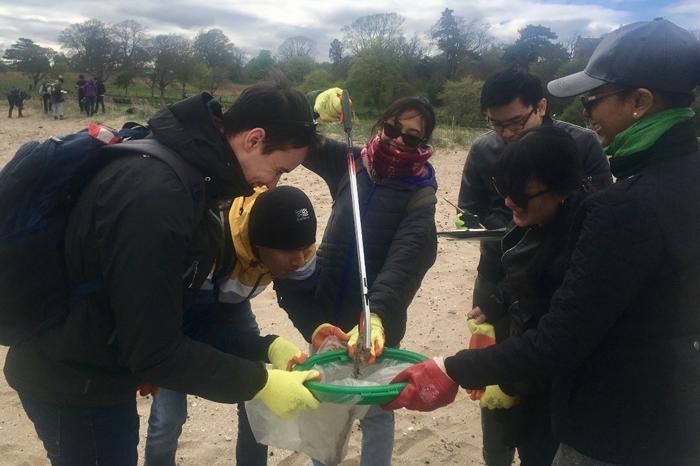 Scholars picking litter