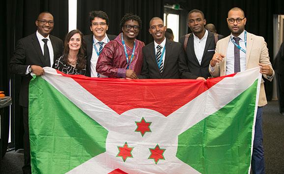 Scholars with flag of Burundi