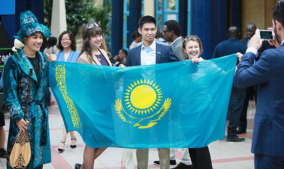 Scholars with flag of Kazakhstan