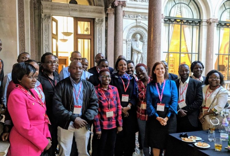 Scholars interact with Joanna Roper and Amina Mohamed at the FCO