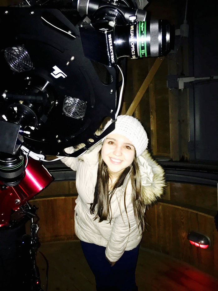 Camila Pantoja and a telescope