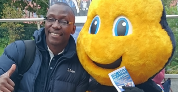 Evans Baines-Johnson poses with bee mascot